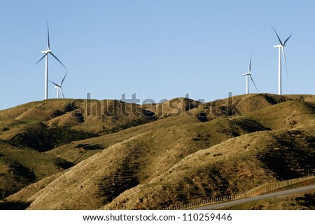 Wind turbines on top of hill - stock photo