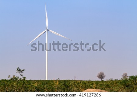 Wind turbines power generator over blue sky