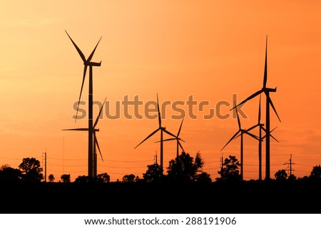 Wind turbines, wind Farms silhouette at sunset in Thailand - stock photo