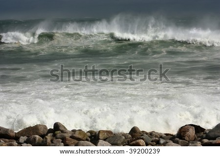 Wind wave and spray - stock photo