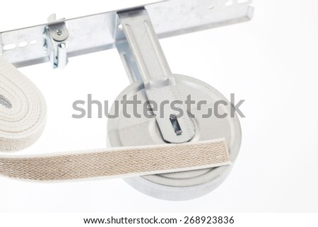 Winder and strap for roller shutter - stock photo