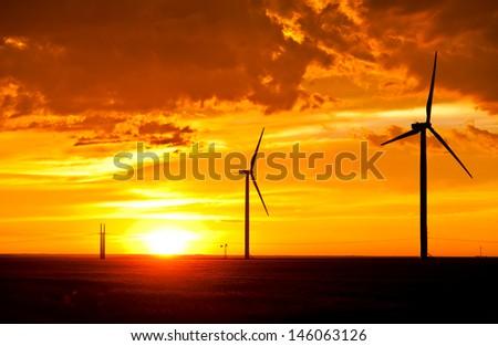 Windfarm at the sunset - stock photo