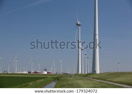 Windfarm with a clear blue sky producing alternative energy - stock photo