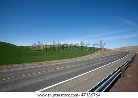 Winding asphalt highway - stock photo
