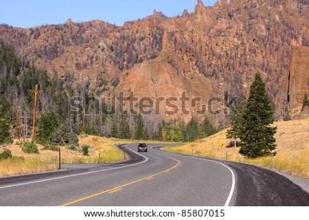 Winding high way near Buffalo Bill state park at Cody Wyoming - stock photo