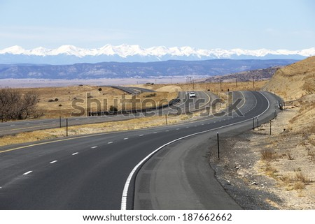Winding highway in New Mexico with views of the Rocky Mountains - stock photo