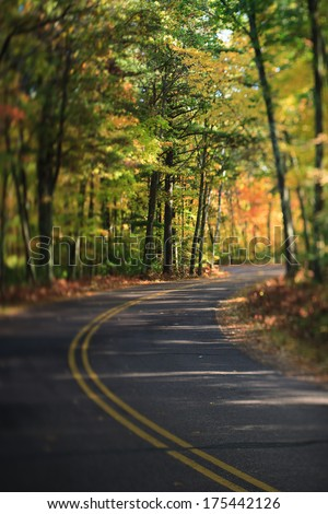 Winding Highway Road Through Fall Trees and Leaves in the North Woods, Wisconsin - stock photo