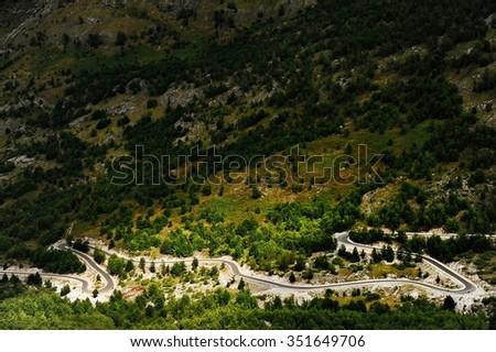 Winding mountain asphalt road in Theth region, northern Albania - stock photo