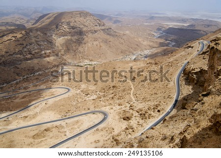 Winding mountain road from Al Mukalla to Aden in Yemen. - stock photo