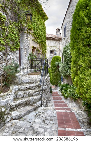 Winding narrow stone streets in Eze near Nice, France.   - stock photo