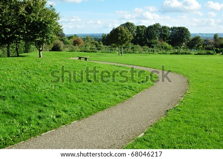 Winding Path in a Green City Park - stock photo