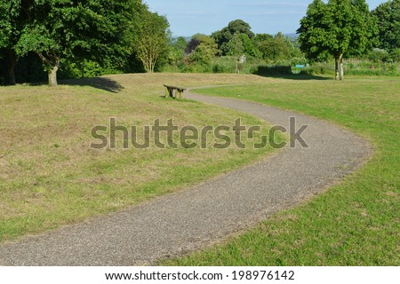 Winding Pathway through a Peaceful City Park - stock photo