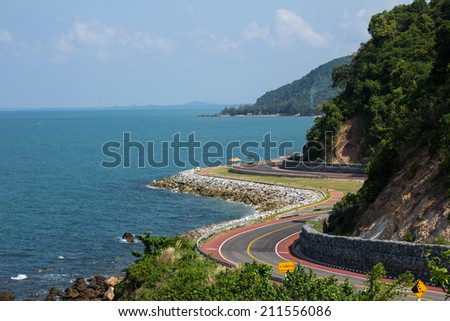 Winding road by the sea in Chanthaburi, Thailand - stock photo