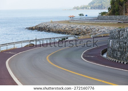Winding road by the sea , Thailand - stock photo