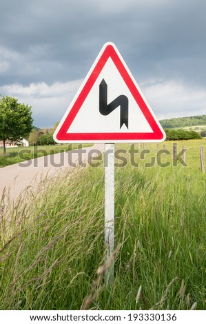 Winding Road Sign in France - stock photo