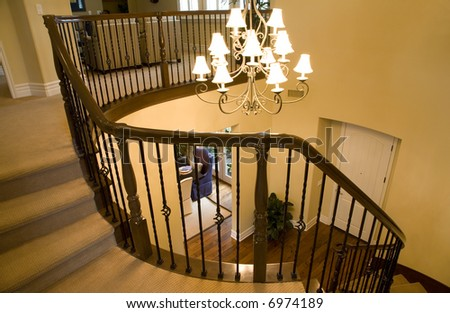 Winding staircase and chandelier. - stock photo