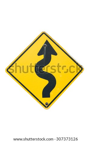 Winding yellow traffic sign against winding road - stock photo