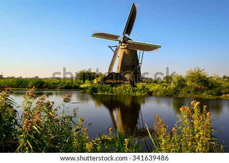 Windmill along the river - stock photo