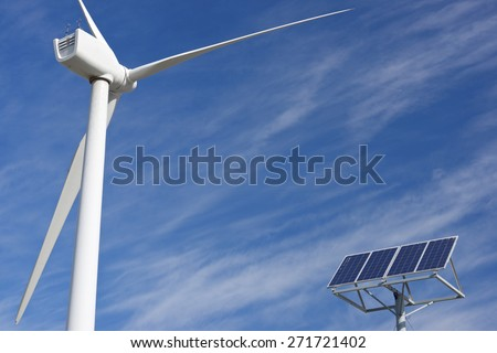 Windmill and photovoltaic panel for energy production, Zaragoza Province, Aragon, Spain. - stock photo