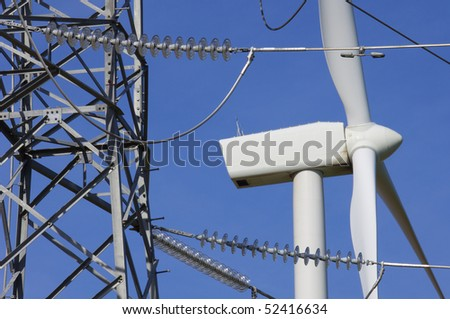 windmill and power line with blue and clear sky - stock photo