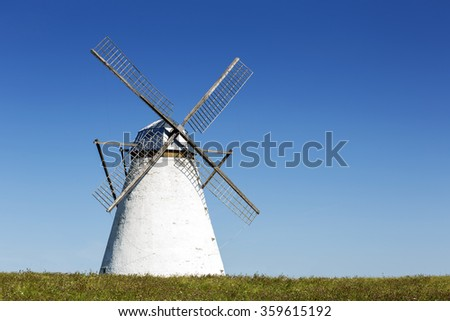 Windmill as farm's decoration of the countryside - stock photo