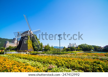 Windmill at Huis Ten Bosch stand in a bright and clear sky, Japan