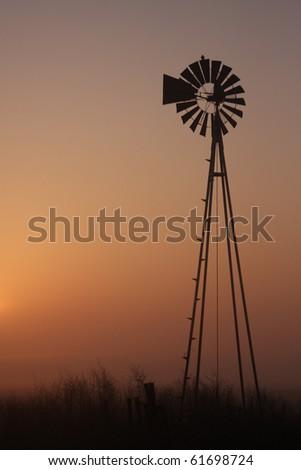 windmill at sunrise - stock photo