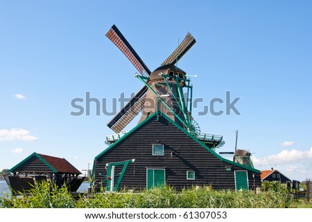 Windmill at the famous Zaanse Schans in Holland - stock photo