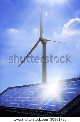 windmill behind a solar panel on a roof