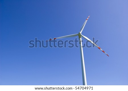Windmill conceptual image.Windmill against the blue sky. - stock photo