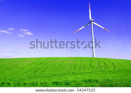 Windmill conceptual image. Windmill on the green field. - stock photo