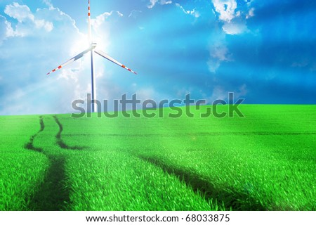Windmill conceptual image. Windmill on the green sunny field. - stock photo