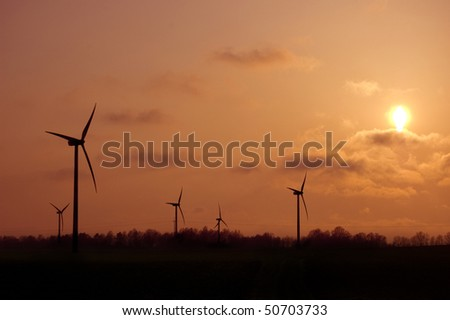 Windmill conceptual image. Windmills in sundown. - stock photo