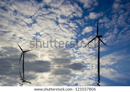 Windmill conceptual image. Windmills in the water. - stock photo