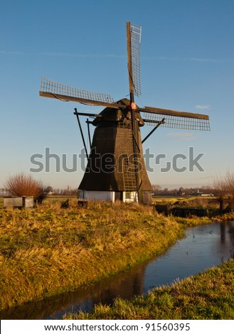 """Windmill """"De Oude Doorn"""" (Anno 1700) in the Dutch village of Almkerk, municipality of Woudrichem , province of North Brabant. The mill, until 1965 in use as a polder mill, is in restoration since 2011 - stock photo"""