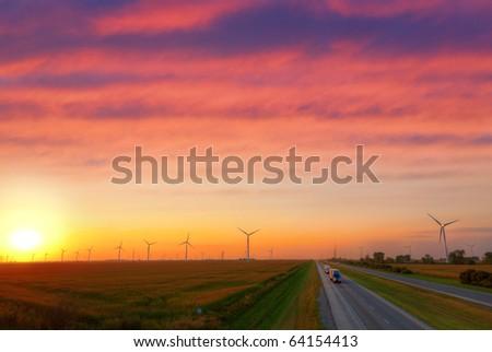 Windmill farm at sunset - stock photo