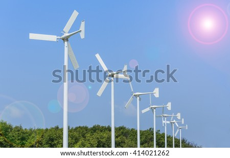 Windmill for electric power production with flare - stock photo