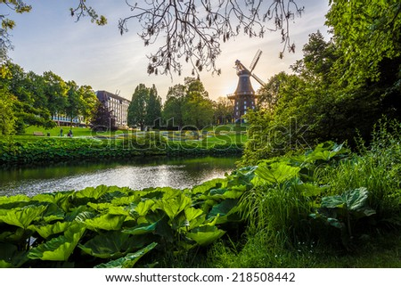 Windmill in city park - stock photo