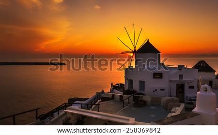 Windmill in Oia Santorini at sunset - stock photo