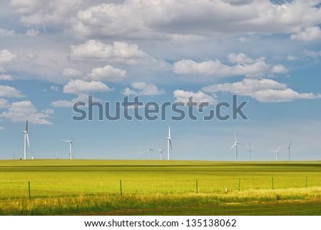 windmill in prairie - stock photo