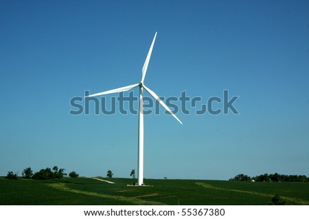 Windmill in southwest Iowa gathers energy from the summer breeze.