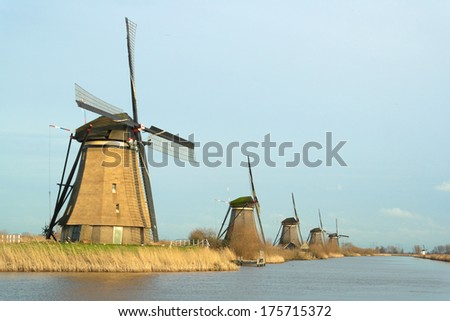 Windmill landscape in the winter at Kinderdijk (the Netherlands).