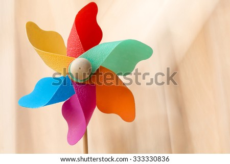 Windmill on a blurred bokeh background. - stock photo