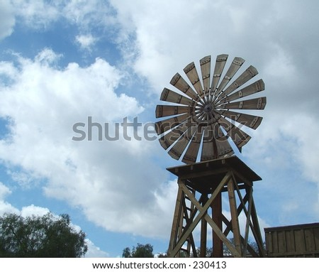 Windmill on cloudy day - stock photo