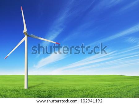 Windmill on field - stock photo