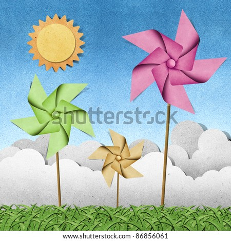windmill on grass field recycled papercraft  background - stock photo