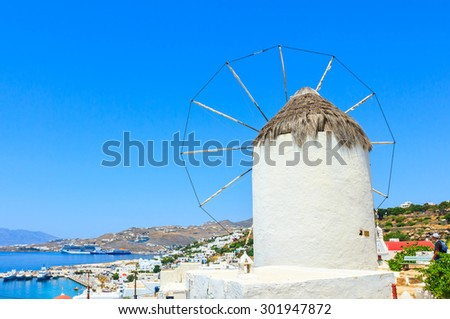 Windmill on hill above city of Mykonos, Greece. - stock photo
