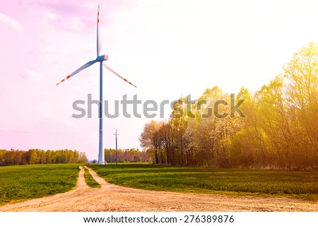 Windmill on the field with country path near forest at summer. - stock photo