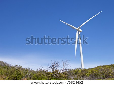 Windmill On Top Of A Hillside - stock photo