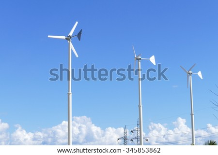 windmill with blue sky background for electricity production - stock photo